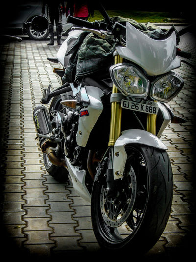 White beauty . The Triumph street Triple . Motorcycle Transportation Land Vehicle Mode Of Transport Street Stationary Outdoors No People Day Close-up Motorcycleporn Motorcycle Photography Motorcycle Lover Motorcycle EyeEm Gallery EyeEmNewHere 2017 Eyeem Awards EyeEm Best Shots Triumph Motorcycle Triumph Triumph Speed Triple Triumph Motorcycles Biker Bike Lover Riders