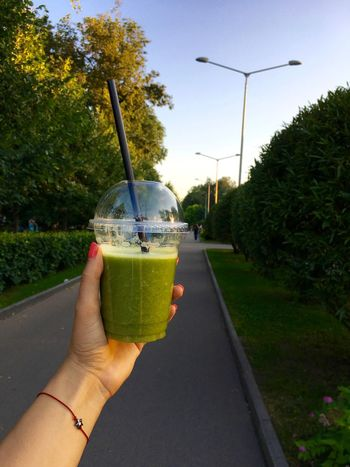One day of smoothie In My Hand Summertime Drink Drinking Glass Food Food And Drink Freshness Green Color Green Smoothie Healthy Eating Healthy Food Healthy Lifestyle Holding Human Body Part Human Hand Lifestyles Outdoors Personal Perspective Refreshment Smoothie Summer Detox