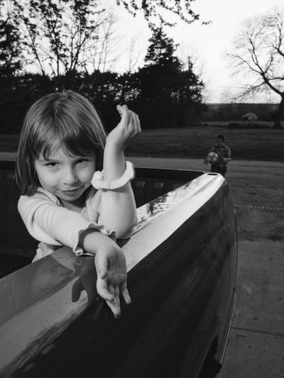 Portrait Of Girl In Pick-Up Truck At Park