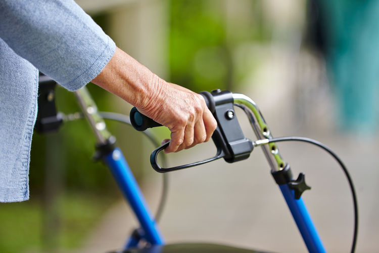 Close-up of hand holding bicycle