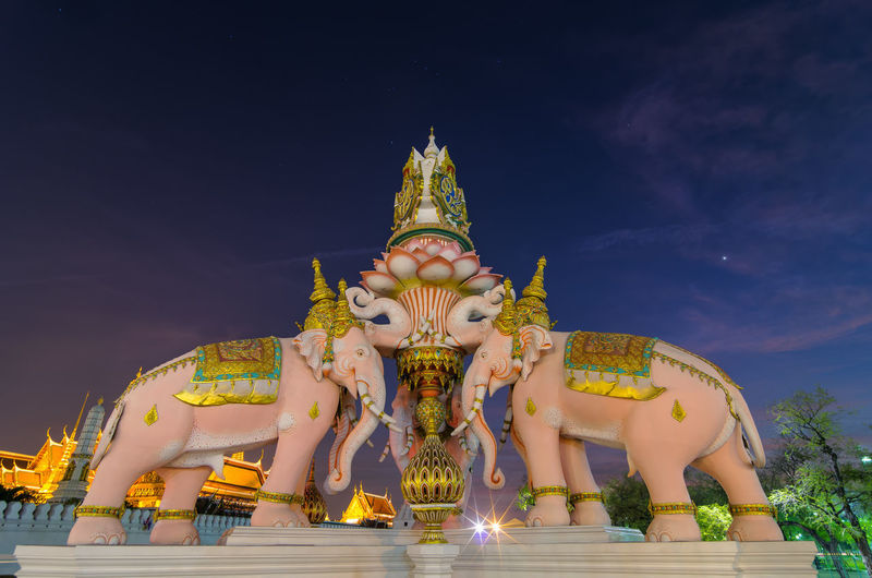 Three Erawan statues and symbols King, In front of Wat Phra Kaew in Bangkok. Palace Thailand Bangkok Wat Elephant Thai Grand Phra Kaew Building Statue Erawan Art Travel Architecture Tourism ASIA Temple Buddhism Decoration Traditional Gold City Culture Field Structure Religion Landmark Royal