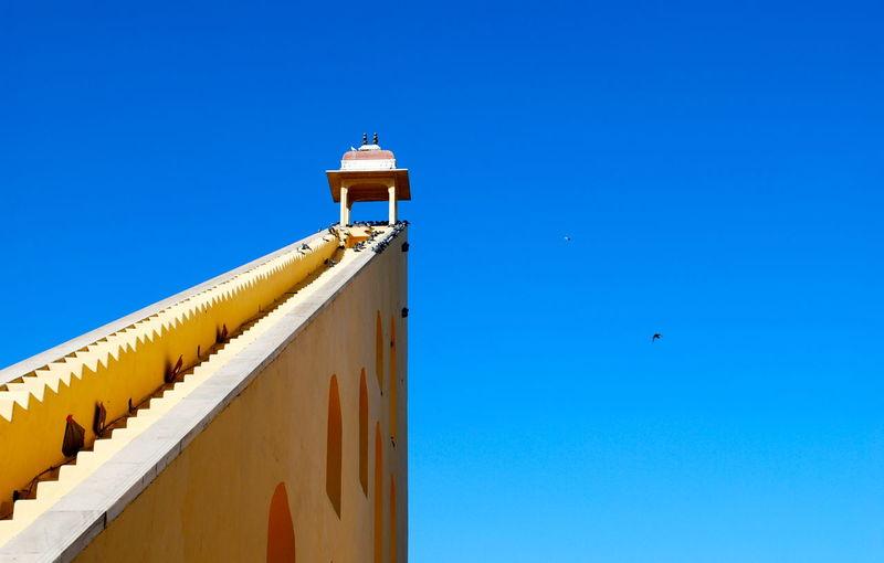 Jantar mantar astronomical observation site against clear blue sky