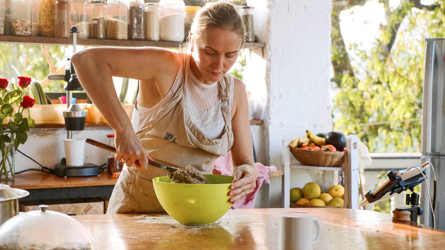 Woman preparing food in kitchen at home