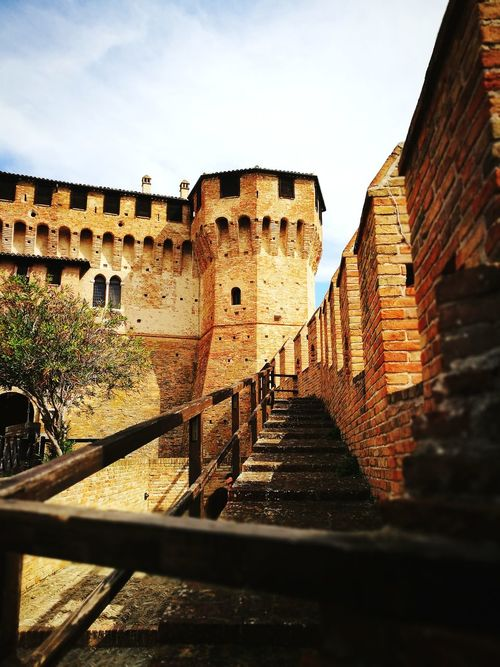 In the heart of 13th century Architecture History Built Structure Travel Destinations Castle Ancient Steps Outdoors Fort Tower Brick Building Sunny Day Sforza Malatesta On The Hilltop Building Exterior Staircase Steps And Staircases Ancient Civilization Day