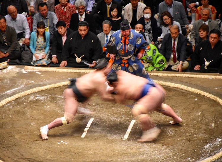 Sumo wrestlers in a bout during the spring tournament in Tokyo EyeEmNewHere Sumowrestler Tokyo Sports Photography Culture And Tradition