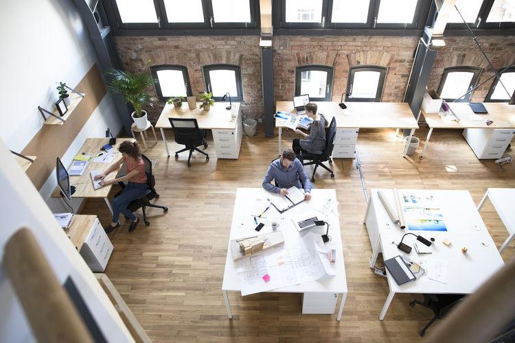 High angle view of people working on hardwood floor
