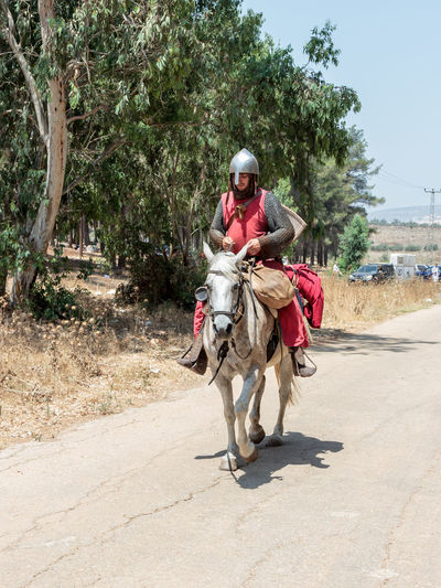 Tiberias, Israel, July 01, 2017 : Participants in the reconstruction of Horns of Hattin battle in 1187 left the camp on horseback and ride go to the battle site near TIberias, Israel 1187 Army Battle Crusaders Defeat Equipment Field Guy De Lusignan Hattin Heat Heritage History Horn Horseman Israel Jerusalem KINGDOM Muslims Palestine Religion Saladin Templars Victory War Weapons