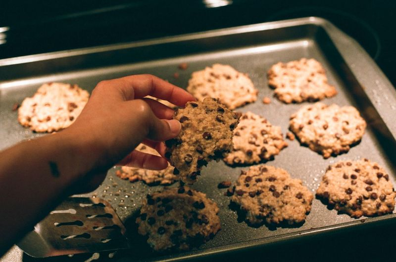 Cropped image of hand holding cookies