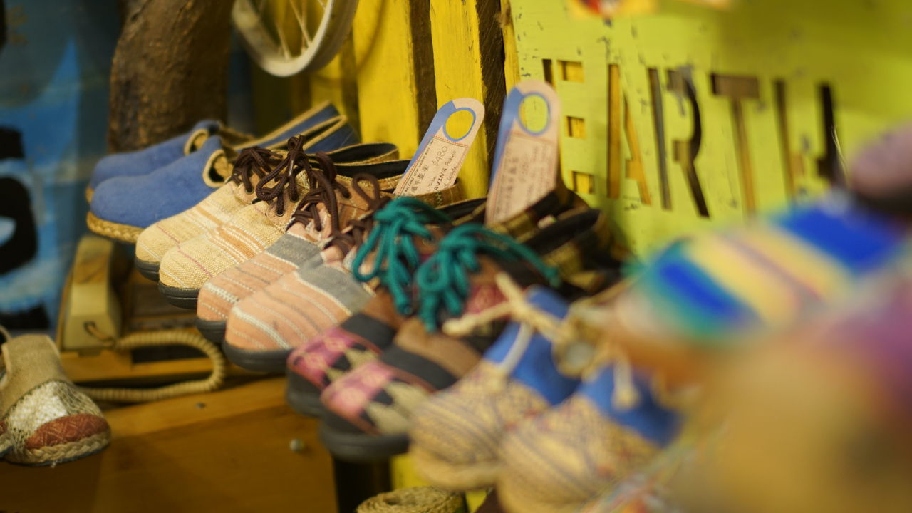 selective focus, for sale, in a row, market, large group of objects, retail, indoors, market stall, no people, hanging, variation, choice, close-up, day, food