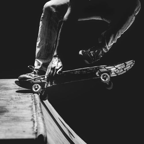 Byw Skateboarding Skater Trick  Protection Hand One Person Sport Skateboard Lifestyles Real People Sports Equipment Human Body Part Skill  Low Section Men Body Part Human Leg Leisure Activity Motion Indoors  Day Stunt Transportation Equipment Black Background Effort