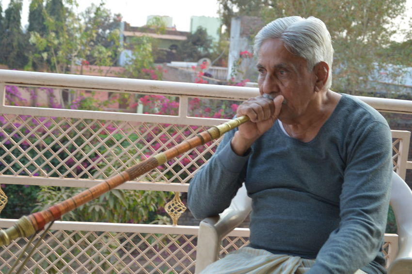 ON MY EXPLORING TRIP Actionshot Alone Casual Clothing Close-up Composition Front View Holding Indoors  Lifestyles Oldman Part Of Person Perspective Portrait Relaxation Sitting Smoking Hookah