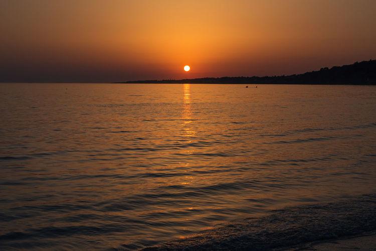 Seascape Ocean Romantic Sky Water Wave Sea Sunset Horizon Beach Moon Beauty Awe Silhouette Coastal Feature Romantic Sky Coast Calm Seascape Tide Atmospheric Mood Coastline