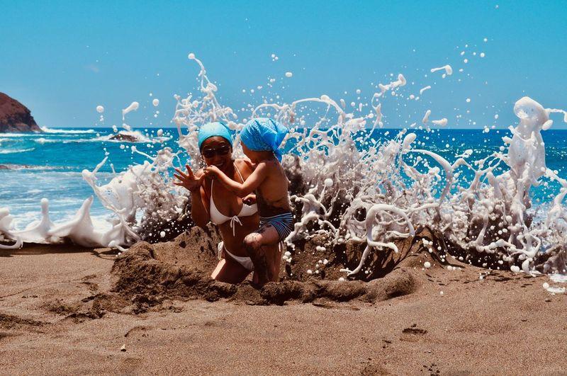 Mother and son enjoying at sea shore