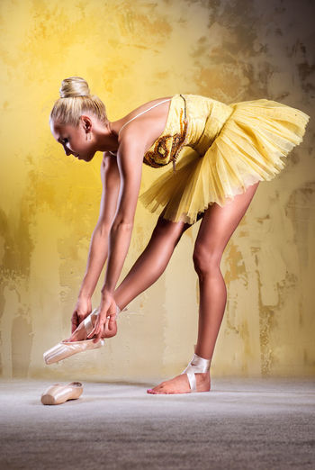 Beautiful ballerina in yellow tutu. Studio shot Alone Artist Ballerina Ballet Ballet Dancer Ballet Tutu Beautiful Woman Blonde Caucasian Choreography Costume Dancer Dress Female Full Length Girl Indoors  One Person Pointe Shoes Professional Dancer Woman