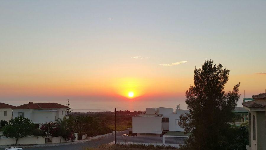 The sun pushing through the horizon Balcony Sunset Cyprus Sea Sunset