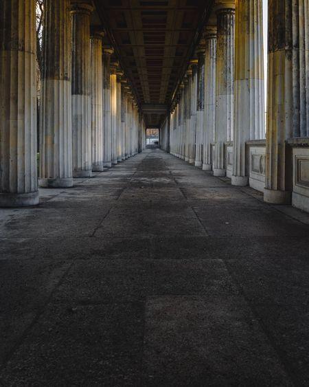 Colonnade in empty corridor