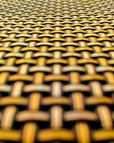 Full Frame Backgrounds Selective Focus Pattern Metal No People Close-up Repetition Indoors  Textured  In A Row Wicker Large Group Of Objects Arrangement Order Side By Side Yellow Brown Design Still Life Intertwined