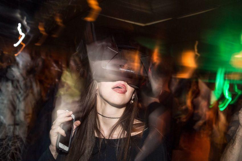 A party goer enjoys a VR art program on an Oculus Rift headset at Spirit Lounge in Pittsburgh, Pa. Oculus Rift Pittsburgh Long Exposure Party Vr