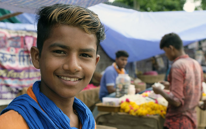 Portrait of a smiling man sitting in market