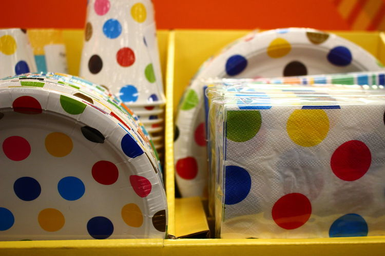 Paper plates and tissue papers with polka dots for sale in store