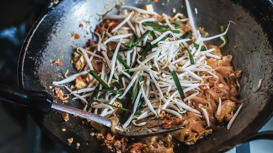 High angle view of meat in cooking pan.pad thai