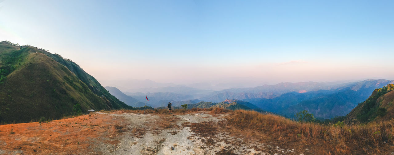 Panorama view on mountain in morning and cameraman enjoying the beautiful nature view.