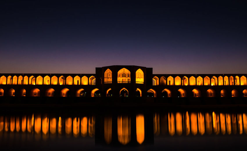 Khaju Bridge at dusk in Isfahan November 15, 2013. Arch Arch Bridge Arched Bridge Bridge - Man Made Structure Connection Culture Engineering Famous Place Forest Historical Building International Landmark Iran Isfahan Khaju Khaju Bridge Light Long No People River