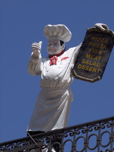 Restaurant Sign Chef Whites Art Blue Sky Cafe Chef Creativity Cultures Front View Fun Human Representation Humorous Humorous Signs Kotor Lifestyles Menu Montrnrgro Restaurant Sign Standing Statue Thumbs Up