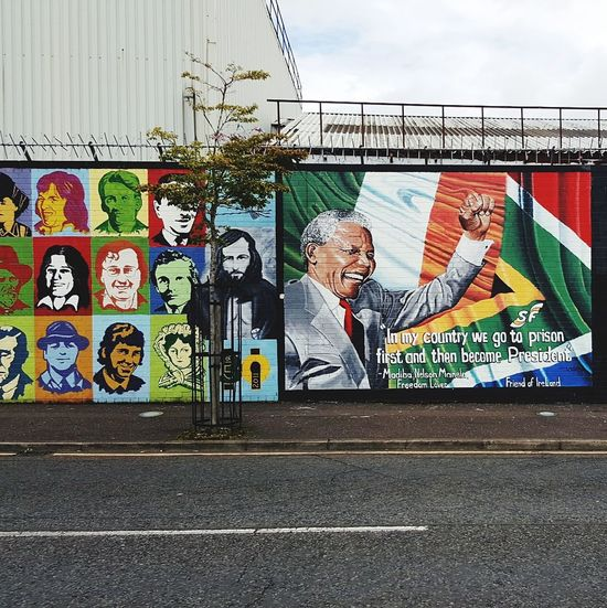 Murals at the Peace Wall of Northerner Ireland, Belfast, August 2016 Resist Graffiti Text Street Art Day Architecture Built Structure Outdoors Building Exterior No People City Sky Politics And Government Troubles Thetroubles Murals Muralsart Unionists Nationalists Catholic Protestant Freedom Prison Prisoner Prison Cell Connected By Travel The Troublemakers The Troublemakers