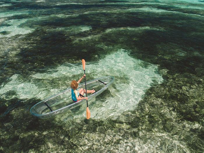Woman boating on sea