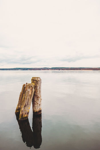 Abandoned Beach Beauty In Nature Day Horizon Over Water Lake Lake View Nature No People Outdoors Reflection Reflections In The Water Rotting Scenics Sea Sky Tranquil Scene Tranquility Water Wood - Material Wooden Post