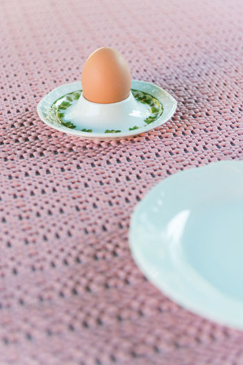 Boiled egg and plate for breakfast on oldfashioned pink plastic placemat EyeEmNewHere Retro Boiled Egg Oldfashioned Pink Color Placemat Plastic Plate Retro Styled