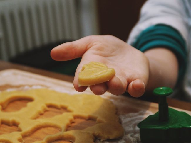 Food Food And Drink Human Hand One Person Hand Real People Indoors  Holding Freshness Preparation  Human Body Part Focus On Foreground Preparing Food Sweet Food Close-up Finger Human Finger Home Interior Lifestyles Temptation Orange
