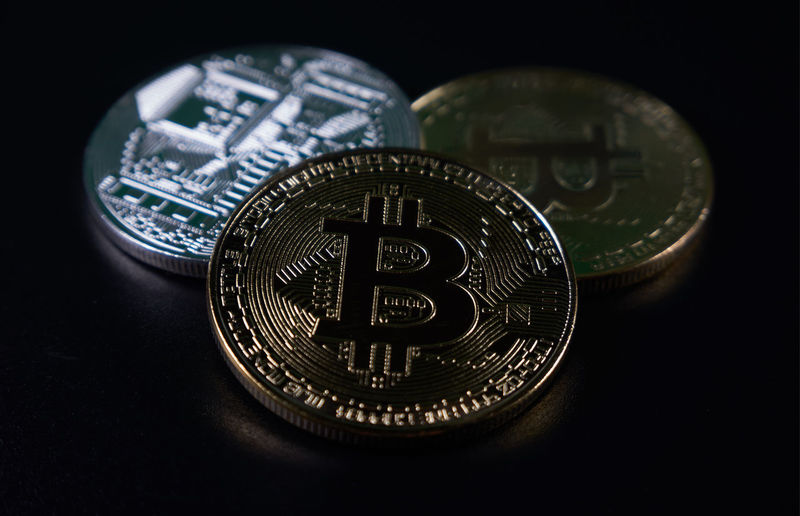 Free golden and silver bitcoins on black background. Selective focus. Currency Gold Wallet Bitcoin Coin Block Chain Blockchain Cryptocurrency Cryptography Digital Currency Money Motherboard Purse Silver  Technological Technology Transaction