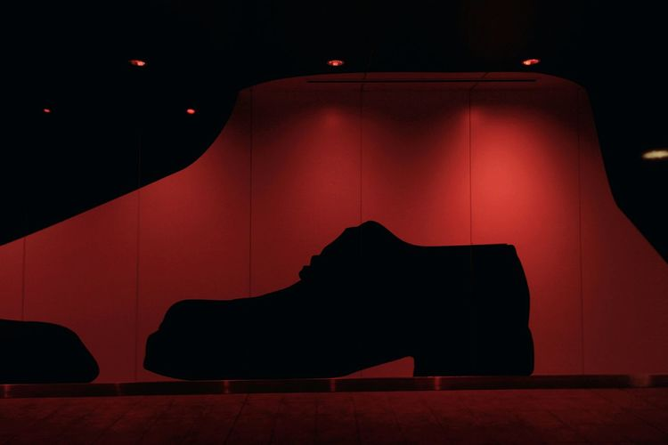 Silhouette shoe in illuminated red light at store