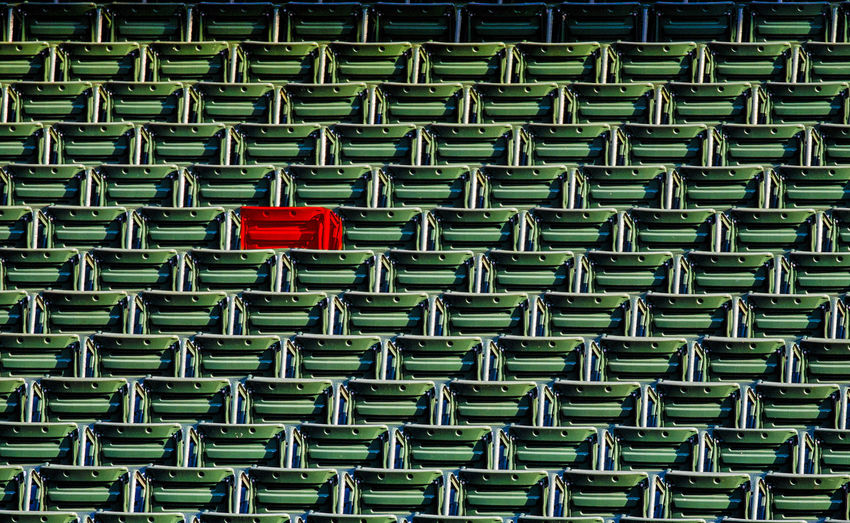 One red seat Stadium Seating Backgrounds Design Empty Stadium Seats Full Frame In A Row Large Group Of Objects Metal No People Pattern Red Repetition Rows Of Seats Seat Side By Side Sport Textured  Tiers