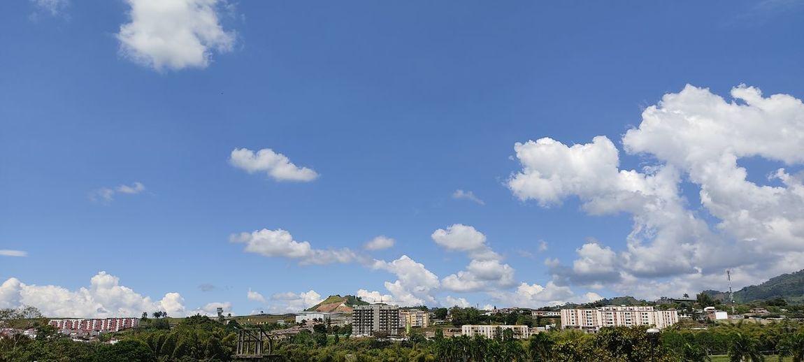Panoramic shot of buildings against blue sky