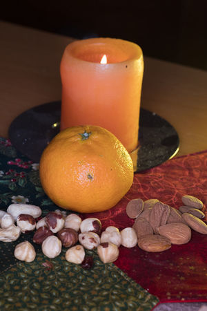 Winter Fruits With Candle Candle Cashew Nuts Nuts Almonds Burning Candle Light Citrus Fruit Clementine Close Up Close-up Dark Background Flame Flash Photography Food Freshness Fruit Illuminated Indoors  No People Orange - Fruit Patchwork Art Table