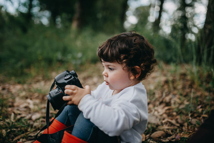 Rear view of child looking camera