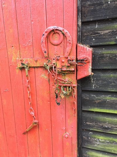 Red door Red Painted Wood Horse Shoe Wooden Texture Day Protection No People Close-up Latch Lock Metal