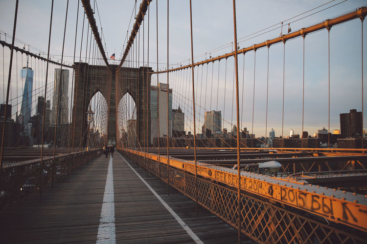 Architecture Bridge - Man Made Structure Brooklyn Bridge  Brooklyn Bridge / New York Built Structure City City Connection Day Engineering Manhattan New York New York City No People Outdoors Sky Steel Cable Sunset Suspension Bridge Transportation Travel Destinations Winter The City Light