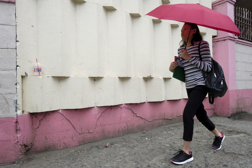 Fujifilm X-Pro2 XF18mmF2R. June 2016. Capistrano cor Chaves St, CDO. Showcase July Street Photography Eyeem Philippines Cagayan De Oro City XF18mmF2.0 Fujifilm X-pro2 Fujifilm_xseries Umbrella