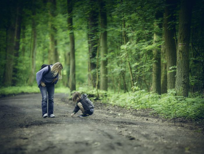 Boy And Woman In Forest
