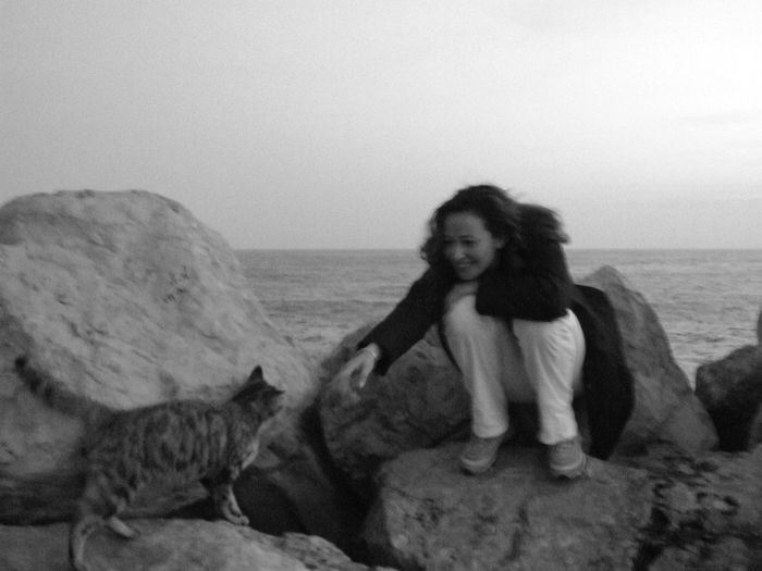 Blackandwhite Blackandwhite Photography Myself Cat Incontricasuali Women Sea Black And White Woman People Peopleandanimals Animal Themes Cats Outdoors Cat Lovers