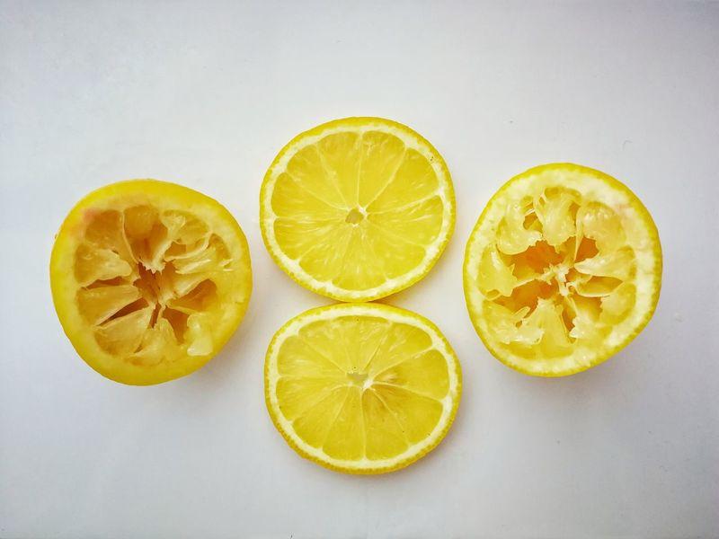 Simplicity Minimal EyeEm Selects Citrus Fruit Healthy Eating Lemon Fruit Vitamin Cross Section Vegan SLICE Vitamin C Healthy Lifestyle Halved Food Styling Food Food And Drink Freshness Yellow Studio Shot