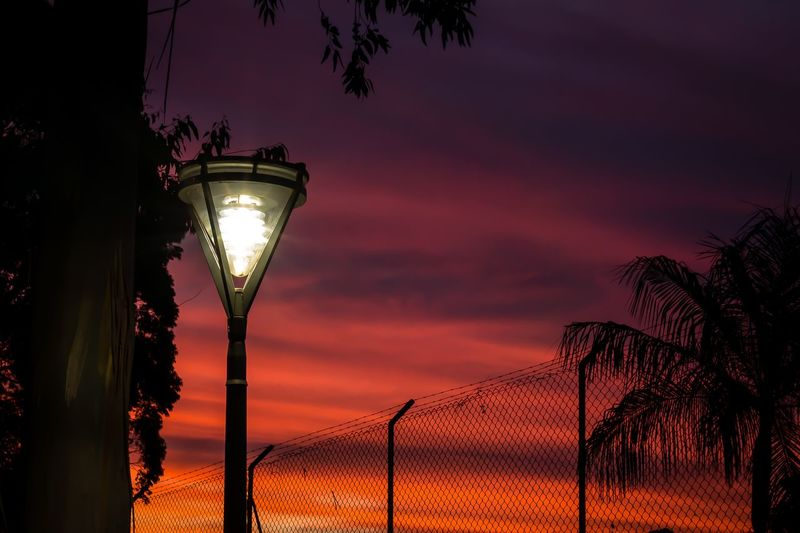 2 lights Illuminated Sunset Sky Fence Chainlink Fence Security Safety Dramatic Sky Capture Tomorrow