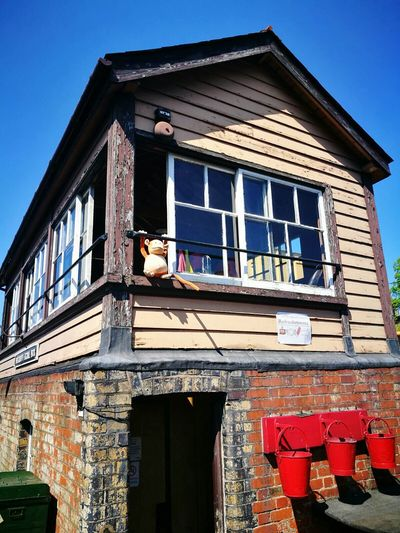 Building Exterior Architecture House Built Structure Window Low Angle View Outdoors Day Residential Building Roof Only Men Sky Adult Adults Only One Man Only One Person People Window Box Politics And Government Monkey Bridgnorth Severn Valley Railway The Great Outdoors - 2017 EyeEm Awards Live For The Story
