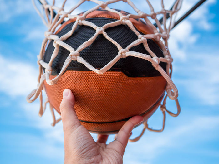 Sports Basketball - Sport Basketball Hoop Body Part Close-up Cloud - Sky Day Finger Focus On Foreground Hand Holding Human Body Part Human Hand Human Limb Leisure Activity Lifestyles Low Angle View Nature One Person Real People Sky Sport Teenager