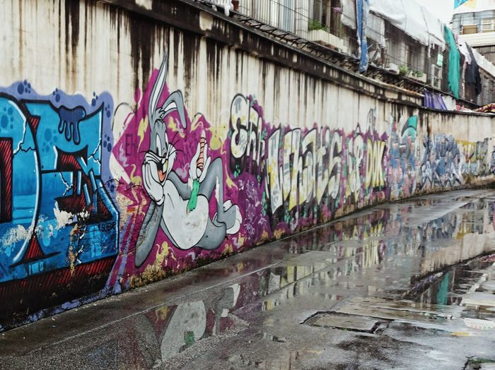 Graffiti Street Art Built Structure Architecture Wall - Building Feature Art And Craft Building Exterior Multi Colored Outdoors Day No People Corrugated Iron Ghetto City