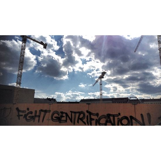 // Fight Gentrification // Urban Landscape Urban Contrast Urban Conflict The New Social Berliner Ansichten Streetphotography Horizon Over Land Graffiti Saying It Construction Site Fence At The Gates Political Street Art Micropolitics Lerone-frames Lerone-doc Twilight